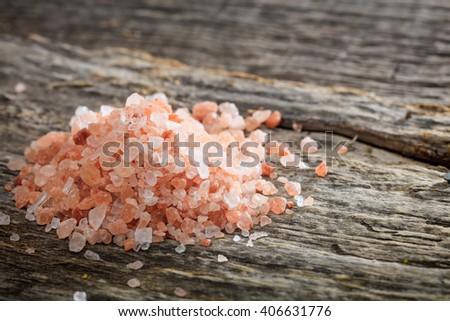 Himalayan pink salt set on old wooden surface - stock photo