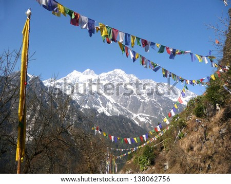 Himalayan Range with snow clad, and mantra flags in Lachen, North Sikkim, India. - stock photo