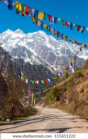 Himalayan Range with snow clad, and prayer flags in Lachen, North Sikkim, India.