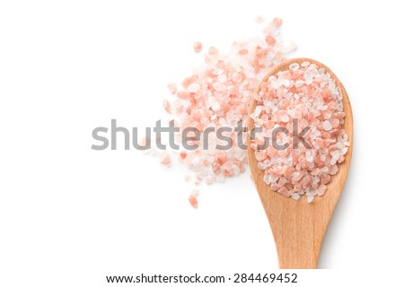 Himalayan salt in white background - stock photo