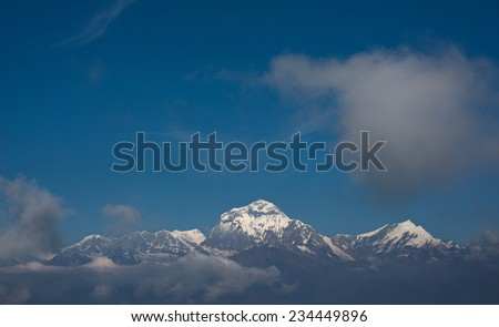 Himalayan snow mountains with clouds and blue sky ( view from Poon hill - Nepal ) - stock photo
