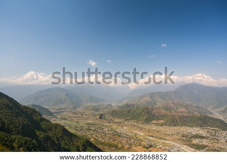 Himalayan view from Sarankot hill. Pokhara, Nepal. Annapurna range and Machapuchare mountain within eyeshot. - stock photo
