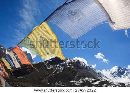 Himalayan view with colorful prayer flags and clear blue sky in Muktinath, Upper Mustang, Nepal - stock photo
