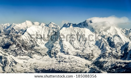 Himalayas mountains Everest range panorama aerial view with Mt. Everest, Nepal - stock photo