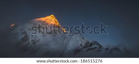 Himalya summits Everest and Nuptse at sunset. Large panoramic view - stock photo