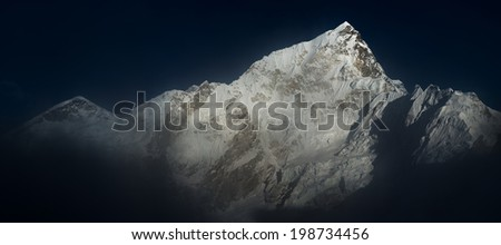 Himalya summits Everest and Nuptse before sunset panoramic view - stock photo