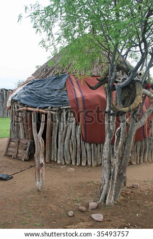 Himba Hut between Angola and Namibia - stock photo