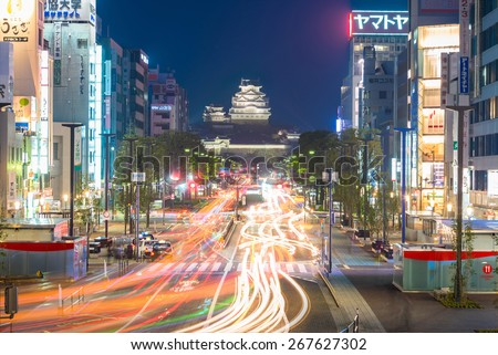 HIMEJI, JAPAN - APRIL 8: Himeji Castle on April 8, 2015 in Himeji, Japan. Himeji city is one of the main tourist attraction. With over 3 million people visit Himeji Castle each year.    - stock photo