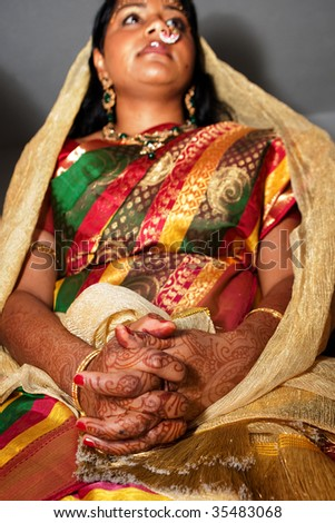 Hindu Brides Hands with henna during a pre-wedding ceremony - stock photo