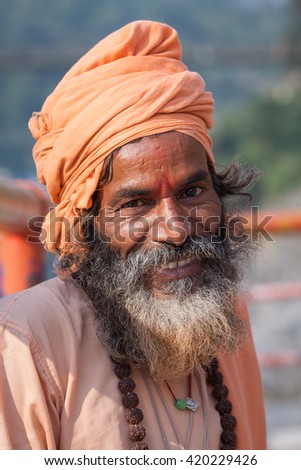 Hindu sadhu holy man, sits on the ghat, seeks alms on the street in Devprayag, Uttarakhand, India . Close up