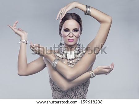 Hindu woman with four arms  - stock photo