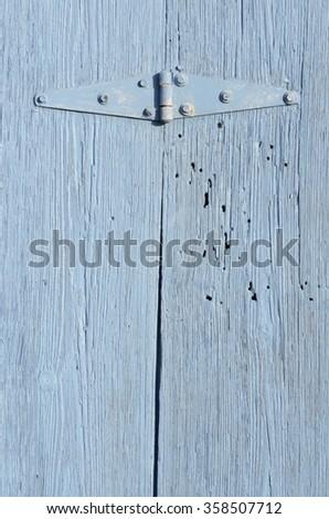 Hinge on Vintage Old Wood Boards Painted Blue - stock photo