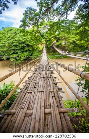 Hinged bridge over the River Loboc in Bohol, Philippines - stock photo