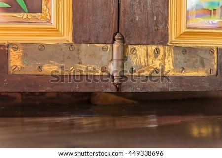 Hinged doors, Old hinge door with brown wood door - stock photo
