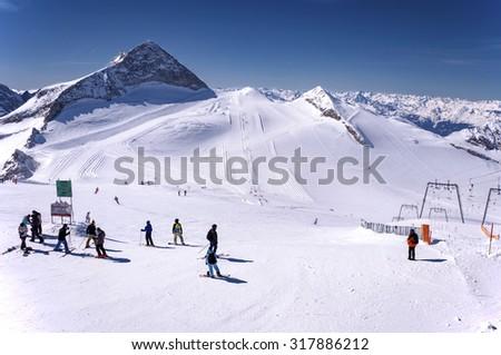 HINTERTUX, AUSTRIA â?? MARCH 13, 2012: Hintertux Glacier with skiers, snowboarders, ski runs, pistes and ski lifts in Zillertal Alps in Austria - stock photo