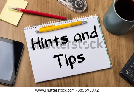 Hints and Tips - Note Pad With Text On Wooden Table - with office  tools - stock photo