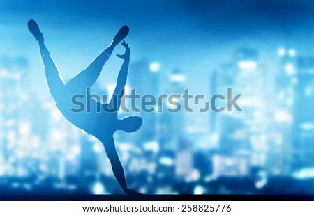 Hip hop, break dance performed by young man in city lights. Nightlife party time - stock photo