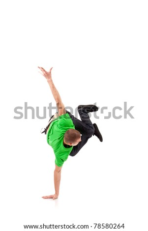 Hip hop breakdancer performing handstand on one hand - stock photo
