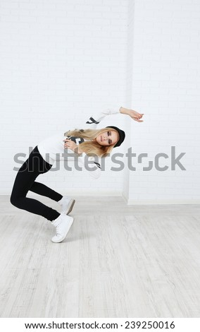 Hip hop dancer dancing on wall background