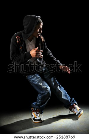 Hip hop dancer performing with strong directional light - stock photo
