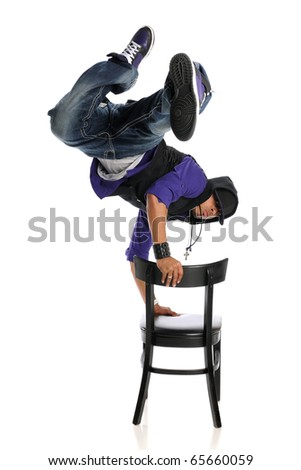 Hip Hop Style Dancer performing usind a chair isolated on a white background