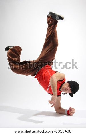 hip-hop style dancer posing on isolated background - stock photo
