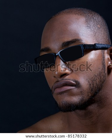Hip muscular black man in sunglasses - stock photo