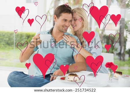 Hip young couple enjoying coffee and desert together against valentines day pattern - stock photo