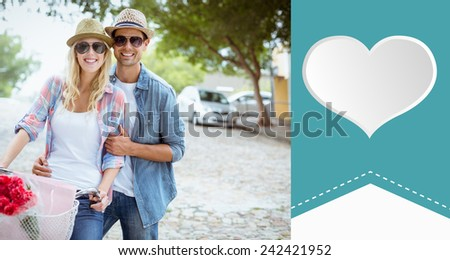 Hip young couple going for a bike ride against heart label - stock photo