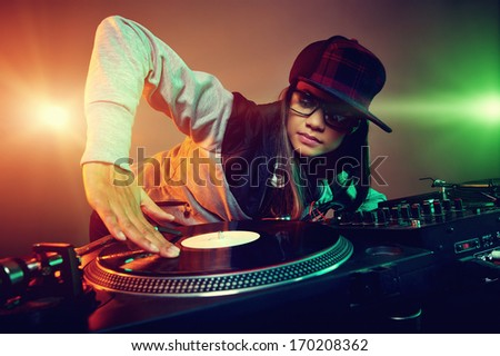 Hiphop dj woman playing at nightclub party lifestyle - stock photo