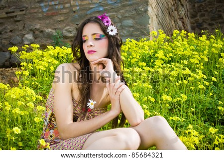Hippie girl looking at the camera with a smile - stock photo