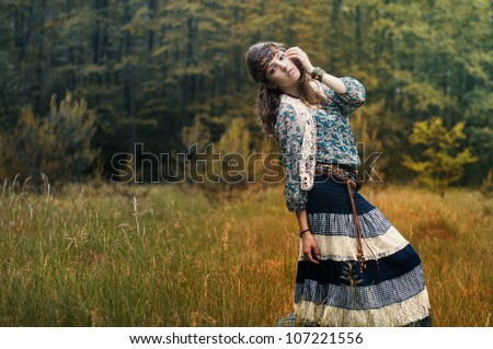 Hippie girl on the background of beautiful scenery - stock photo