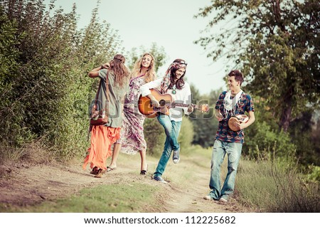 Hippie Group Dancing in the Countryside - stock photo