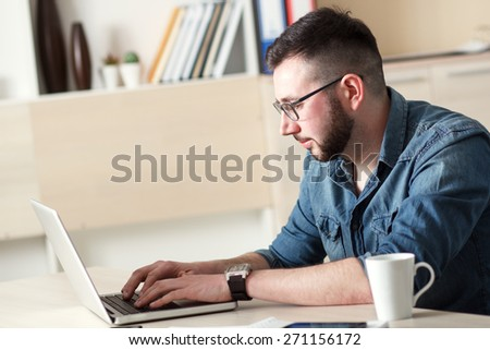 Hipster at work - stock photo