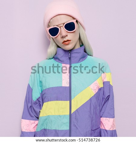 Hipster Blonde Lady in fashionable hat beanie Vanilla pink glasses Autumn Winter
