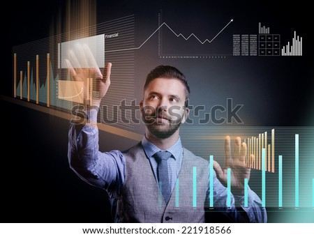 Hipster businessman working on digital virtual screen and business strategy as concept, isolated on black background - stock photo