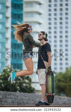 hipster couple in love on the seaside - stock photo