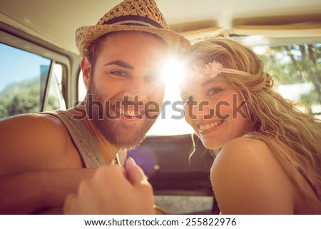 Hipster couple on road trip on a summers day - stock photo