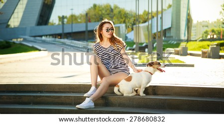 Hipster Fashion Girl with her Dog in the City. Modern Youth Lifestyle Concept. Wide Format Perfect for Website Header or Slider. - stock photo
