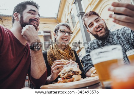Hipster Friends In Fast Food Restaurant Taking Selfie