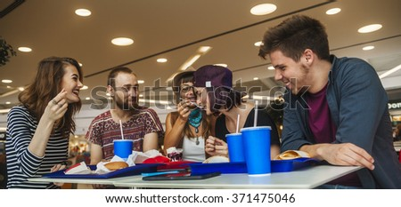 Hipster Friends In Mall Eating Fast Food