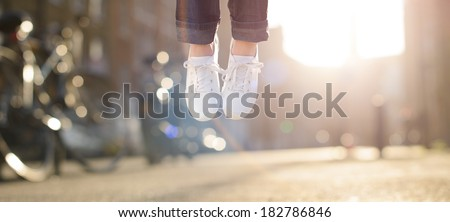 Hipster girl feet jumping concept series - stock photo