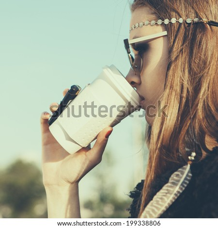 Hipster girl in sunglasses with drink coffee. Close-up lifestyle outdoor portrait - stock photo
