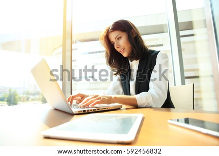 Hipster Girl use Laptop huge Loft Studio.Student Researching Process Work.Young Business Woman Working Creative Startup modern Office.Analyze market stock,new strategy. Horizontal