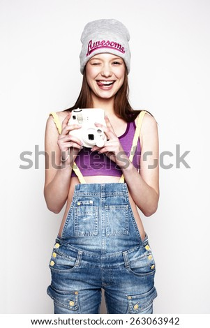 Hipster girl with a photo camera  - stock photo