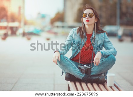 Hipster girl with retro camera - stock photo