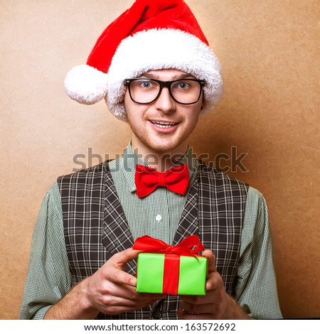 hipster in Santa Claus clothes with the box present - stock photo