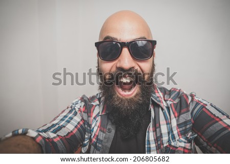 hipster long bearded and mustache man with shirt squares selfie - stock photo