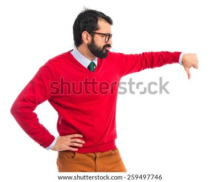 Hipster man doing bad signal  - stock photo