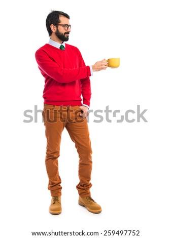 Hipster man holding a cup of coffee  - stock photo